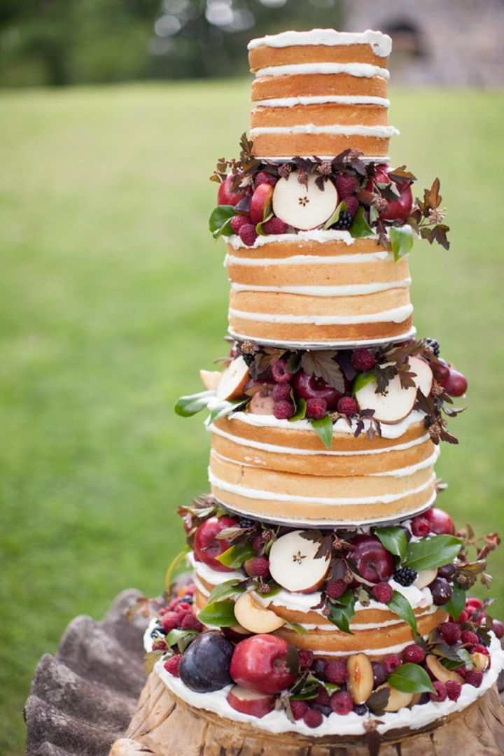 """""""naked"""" wedding cake with fruits in between layers 