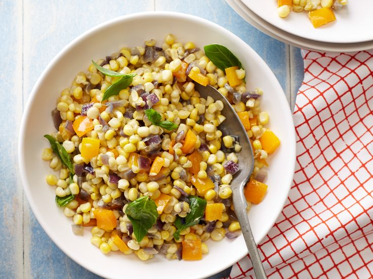 Confetti Corn by Ina Garten via foodnetwork: Cook the kernelsl witih onoion an d bell pepper and toss with a mix of fresh green herbs. #Corn #Herbs #Healthy