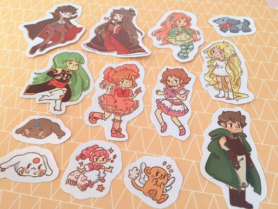 14 glossy stickers featuring characters from Clamp studio anime. Series featured in this pack are Cardcaptor Sakura, Chobits, Code Geass, XXXholic, Tsubasa Chronicles, & Kobato  Printed on high gloss fade-proof paper. Please e-mail any questions to me at: peachmagica@gmail.com or visit my F.A.Q. Thank you! ♥  These images were altered to discourage art theft and you will receive the original stickers with smooth and bright colors. ( ´ ▽ ` )    © 2016 Peach Magica