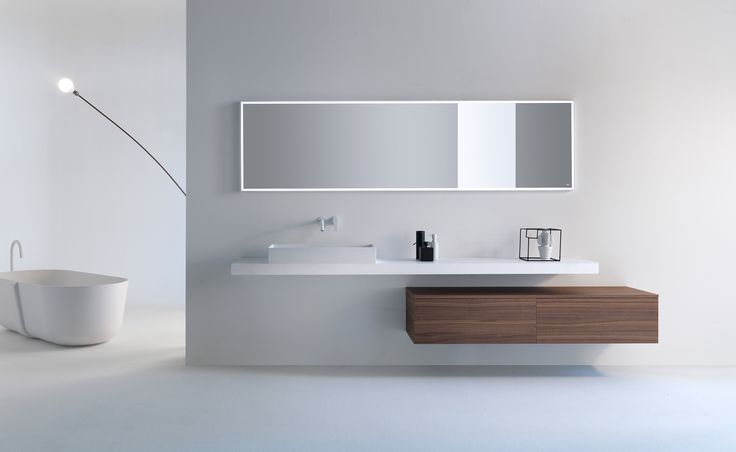 Timeless refinement for the modern bathroom. VIAVENETO ELEMENTS composition with self-supporting top in Cristalplant Biobased, on-top washbasin and double-drawer base with Natural Walnut top. Cristalplant mirror with LED lighting. Follow us on it.pinterest.com/falperdesign