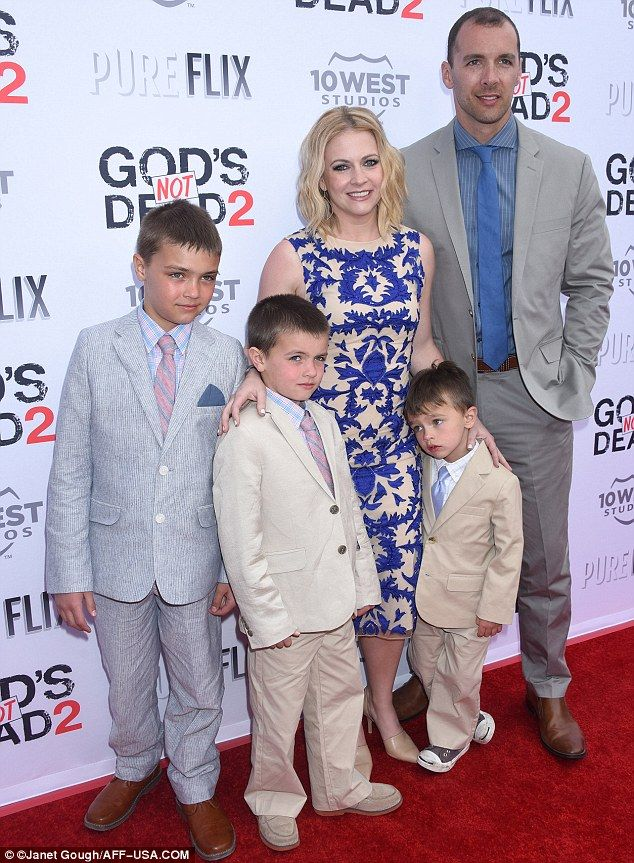 Family affair: Melissa attended the screening with her husband, Mark Wilkerson, and their three sons - Mason, 10, Brady, aged eight, and Tucker, aged three