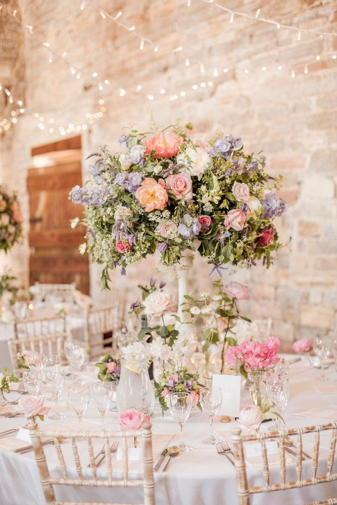 "Romantic pastel country garden centrepiece - barn wedding flowers - Images by <a href=""http://www.naomikenton.com"" target=""_blank"">Naomi Kenton</a>"