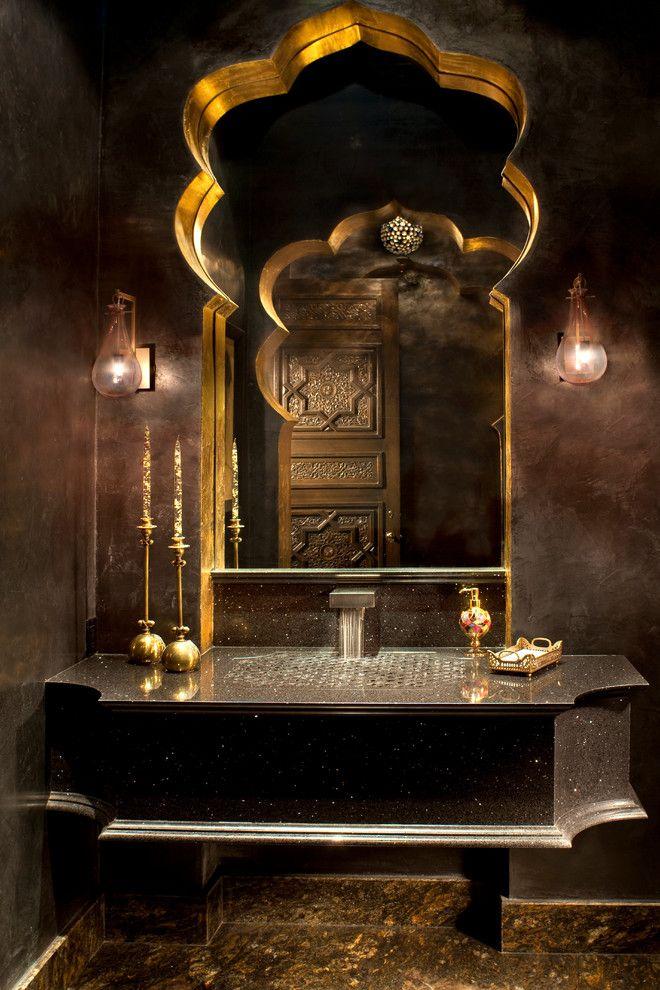 Bright Moroccan Mirror look Other Metro Mediterranean Bathroom Inspiration with arch black counter black vanity brown walls dark walls gold candlesticks interesting sink mirror