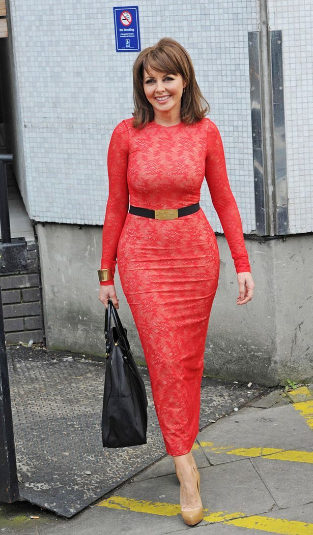 Whoa Carol! Style queen Vorderman drops clanger with red lace dress