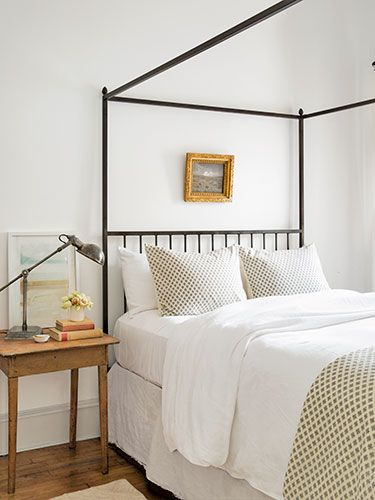 Clover-printed shams and a duvet cover by John Robshaw are the focal point of this simple bedroom.