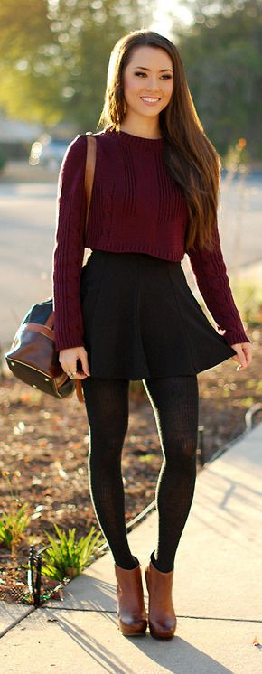Crimson oxblood sweater + black skater skirt + black tights + brown booties