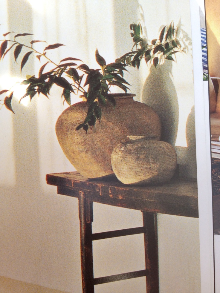 Love these stone pots for an entrance hall table