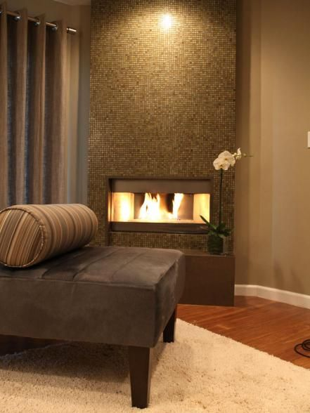 A column of small taupe tiles creates a fireside mosaic. Glass tiles are easy to clean with a wet cloth and mild detergent. Disadvantage: Tiles are hard to install and prone to scratches. Design by Christopher J. Grubb
