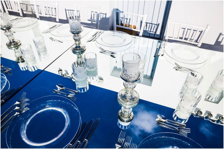 It all starts simple with the blue sky and the white of the Cycladic villa reflected on the wedding table!