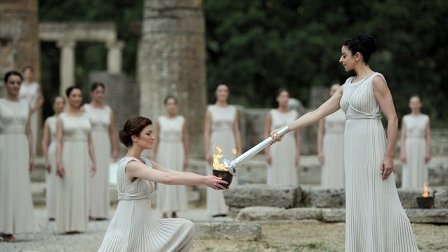 """""""The Olympic Flame for the London 2012 Games is lit in Ancient Olympia.  Actors dressed in the robes of the ancient Greeks perform in the ancient Olympic stadium following the lighting ceremony at the Temple of Hera in Ancient Olympia, Greece."""" ~ just beautiful! :D"""