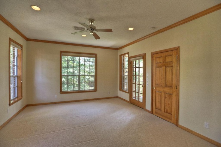 Down a private hall the master bedroom 16x14 has beautiful relaxing views of the treed Hallway to master bedroom