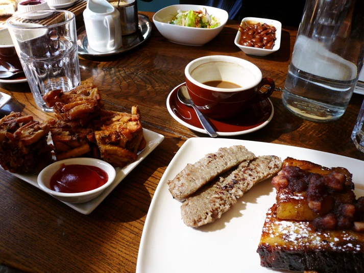 Marben Restaurant (Toronto, Canada). Brunch: bread pudding french toast with sausage, little bird salad, side of pork and beans, and fries kennedy.