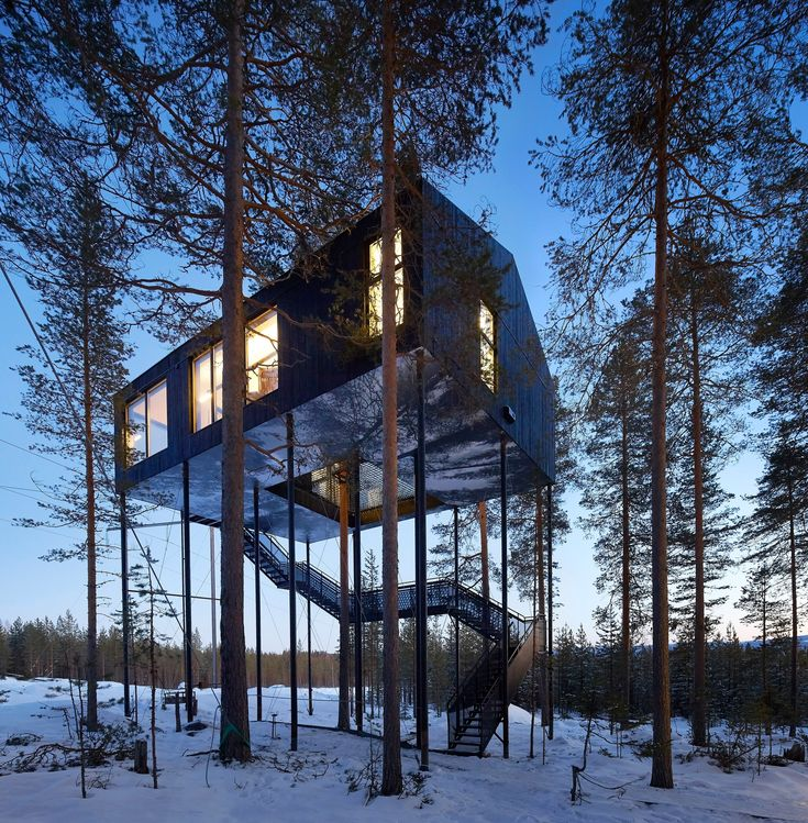 Hufton + Crow's new photographs capture Sweden's Treehotel at sunset