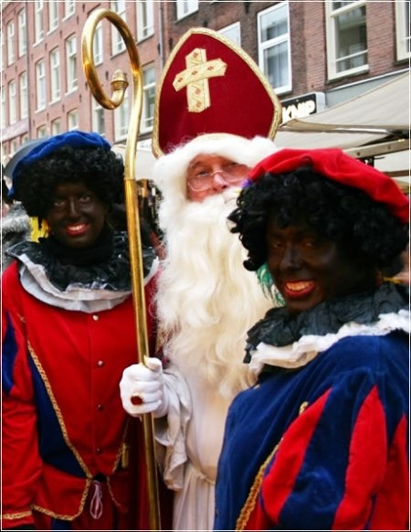 """Sinterklaas met zijn Zwarte Pieten - A yearly-Dutch tradition. To learn about this, you should listen to David Sedaris on YouTube, reading from his book about """"Six To Eight Black Men"""" here:  http://youtu.be/sbJpRLhaSqs"""
