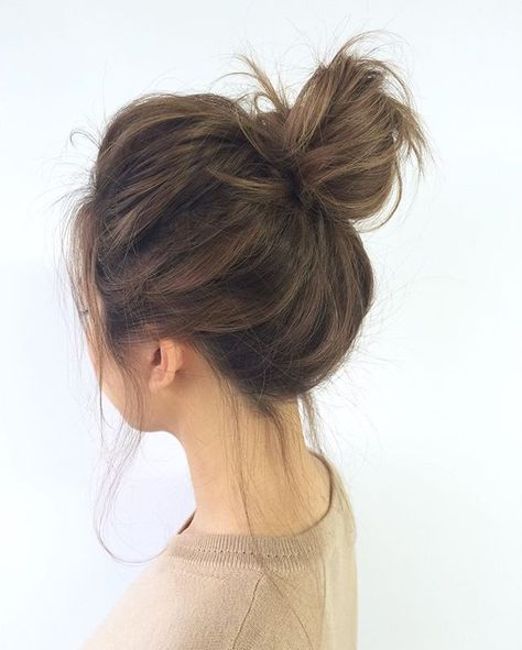 Master the messy bun with @StyleCaster's hair inspiration roundup | loose bun medium hair