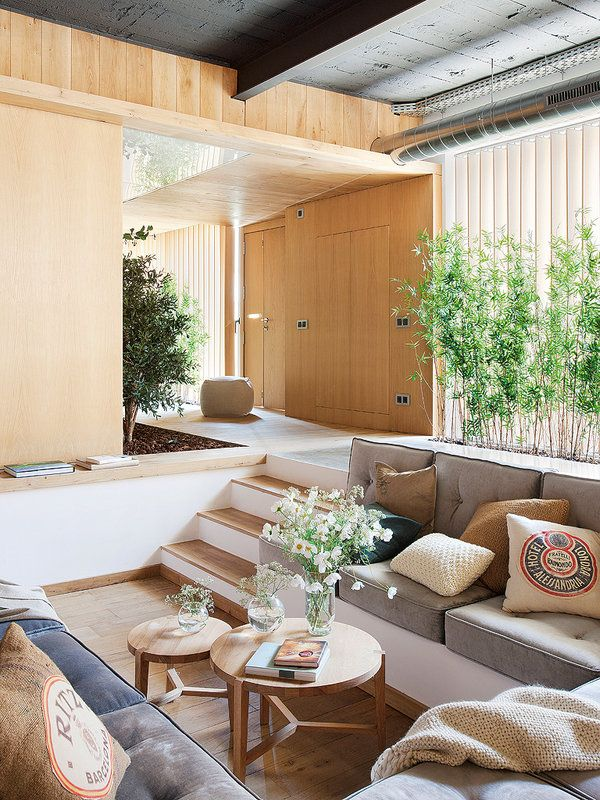 Ultra-modern house with amazing layout in Barcelona, Spain / Gorgeous sunken living room / conversation pit surrounded by greenery.