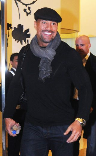 Dwayne Johnson in flat cap & scarf