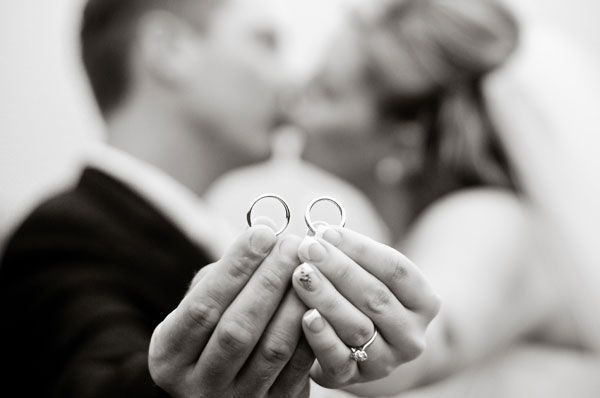 This creative wedding photo is a great way to show off both your wedding bands!