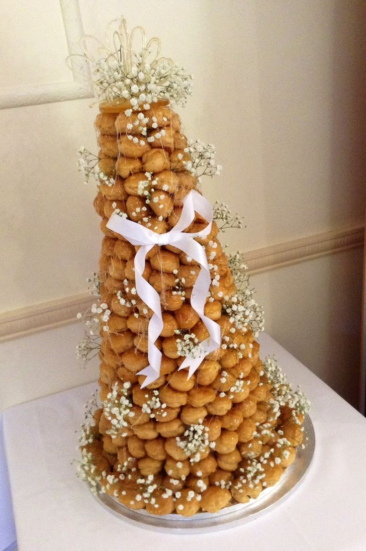 Croquembouche  Fill with tiramisu cream! How awesome would that be?! No melting cake to worry about! Love it!!!!!