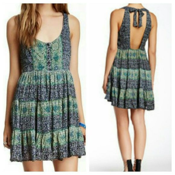 Angie Babydoll Halter Dress - new with tags Never been worn and still has the tag. Scoop neck with partial button closure, halter straps, ruffled hem, 100% rayon. Nordstrom  Dresses
