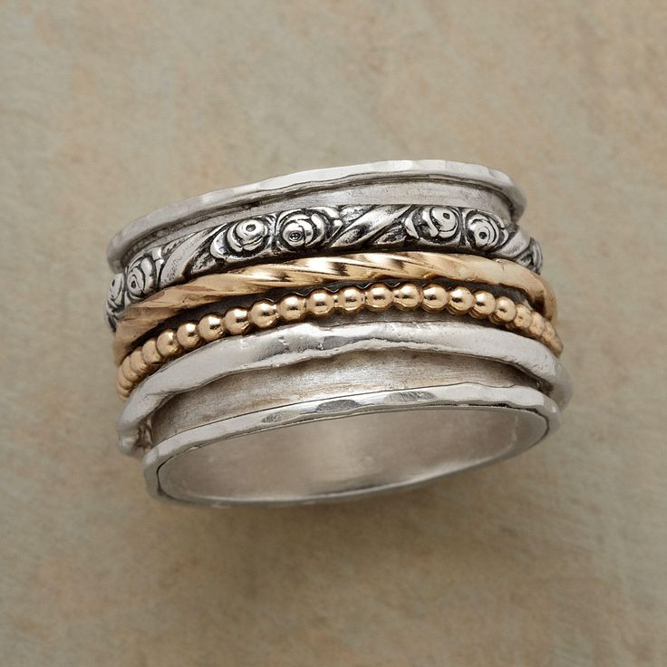 ANTHOLOGY RING--With four rings spinning in a single volume, this anthology band ring has many stories to tell. Two of the revolving rings match the sterling silver base band