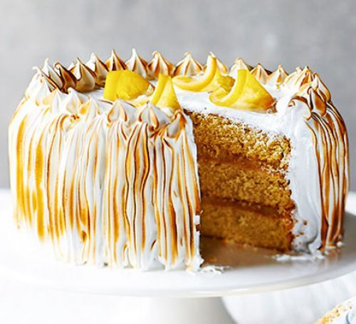 Lemon meringue cake - Take lemon meringue to a new level with this caramel-infused sponge filled with lemon curd and topped with Italian meringue.