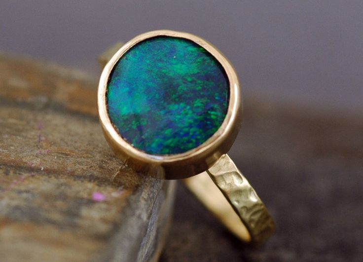 Acceptable engagement ring...Black Opal in Recycled 18k Yellow Gold Ring- Made to Order. $1,800.00, via Etsy.
