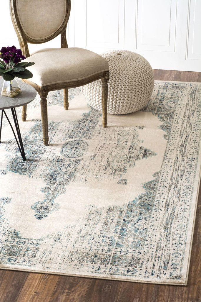 'ivory' rug   appleandoaknash.com  Apple & Oak   this ivory and blue carpets perfect for any living room or bedroom