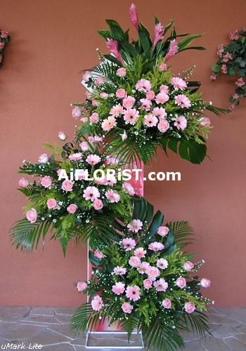 Pink flower stand of Ginger Flowers, Imported Roses and Gerberas.