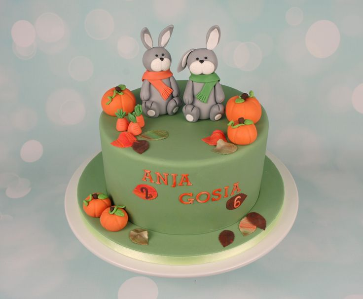 Rabbits cake. Autumn theme with pumpkins