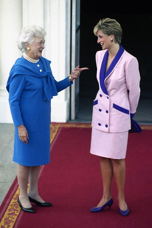 October 5, 1990: Diana, Princess of Wales, is greeted by first lady Barbara Bush upon arrival at the North Portico of the White House in Washington. Mrs. Bush hosted coffee for Diana. (AP Photo/Bob Daugherty)