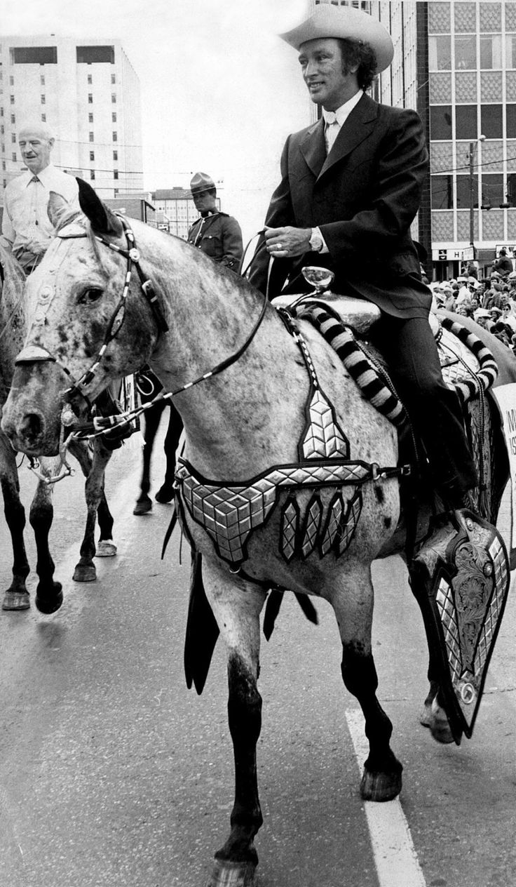 Late prime minister Pierre #Trudeau rides an appaloosa horse at the #Calgary #Stampede parade on July 13, 1971 (Ken Pole / The Canadian Press) | #cdnpoli #Canada