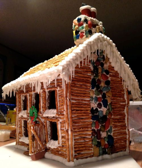 Pioneer style log cabin gingerbread house made with pretzels.