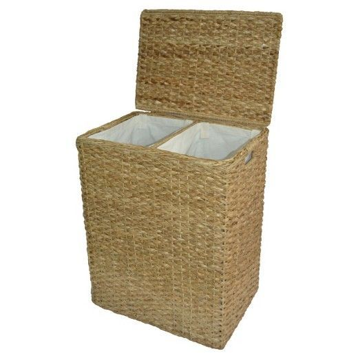 """• Made of seagrass and metal<br>• Measures 25""""x14""""x20""""<br>• Design features lid, cutout handles and interior sorter<br><br>Separate the laundry with ease with the Seagrass Rectangular Divided Hamper in Tan from Threshold. This wicker hamper with lid is an attractive way to keep dirty clothes stored."""