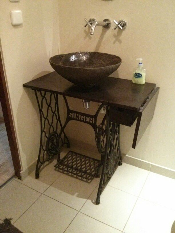 Treadle sewing machine base, made into a sink base. Note the flip top.