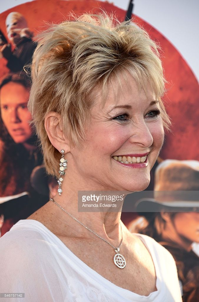 Actress Dee Wallace arrives at the premiere of Momentum Pictures' 'Outlaws and Angels' at the Ahrya Fine Arts Movie Theater on July 12, 2016 in Beverly Hills, California.