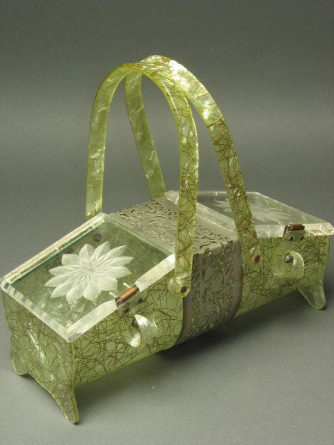 vintage lucite handbag with daisies.  I can't imagine....