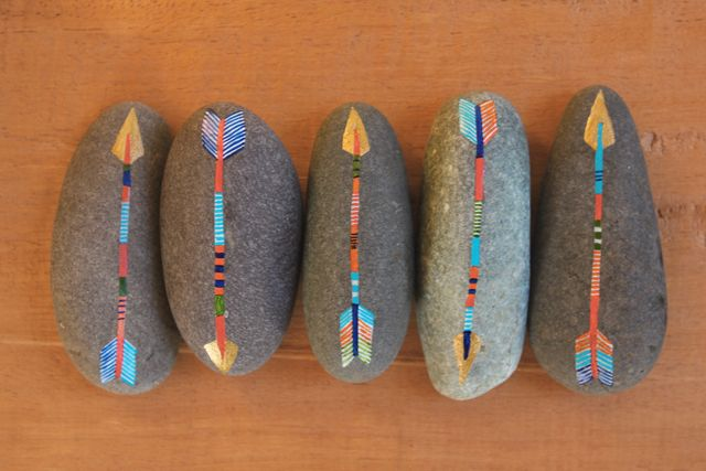 Geninne's painted arrow rocks have inspired an idea for a #girlguide wide game.