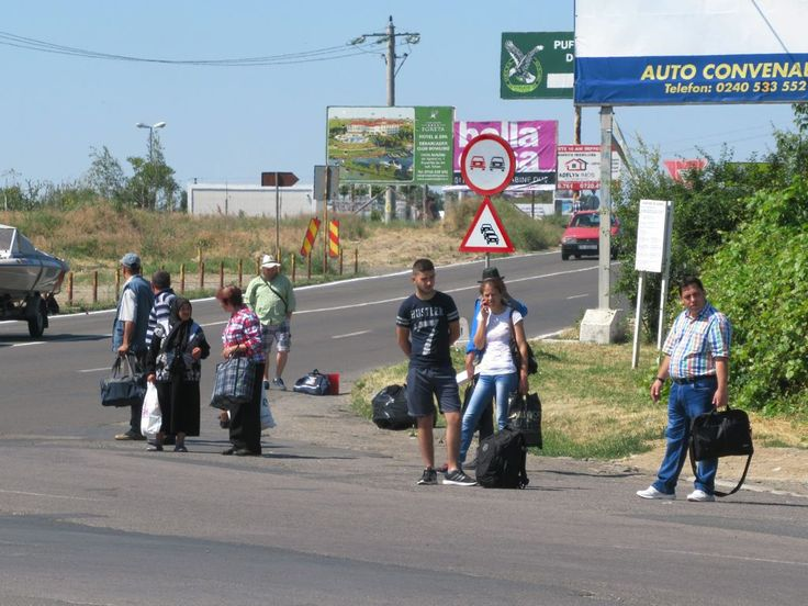 These local hitchhikers at Tulcea, Romania, are hoping for a ride to Bucharest.