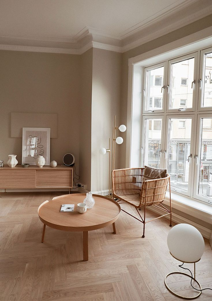 Beautiful Minimal Living Space Decorated In Warm Neutrals Soft Pink Beige Walls And Wooden Flooring With Abstract Art House Interior Cheap Home Decor Interior #nice #decor #in #living #room