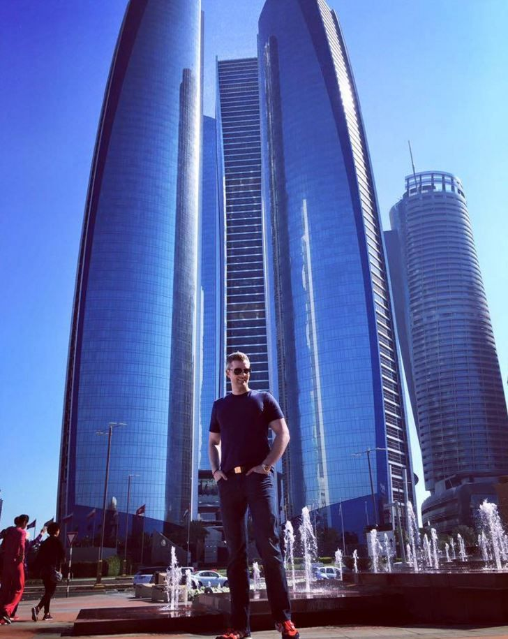 Behind Ryan Serhant is Etihad Towers - the building featured in Fast & The Furious 7.