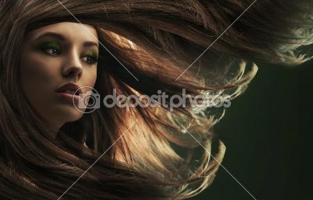 Portrait of a young woman with long hair by konradbak - Lizenzfreies Foto