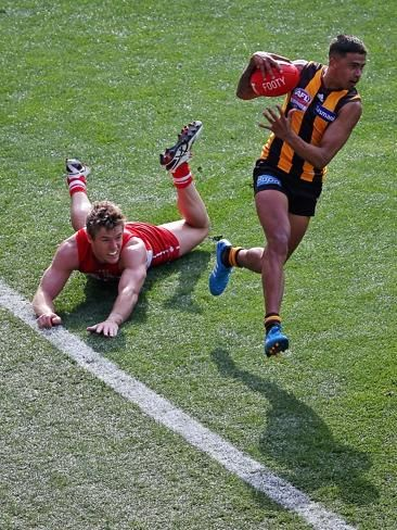 2014 AFL grand final | Herald Sun | Luke Parker can't lay a glove on speedster Brad Hill. Picture: George Salpigtidis
