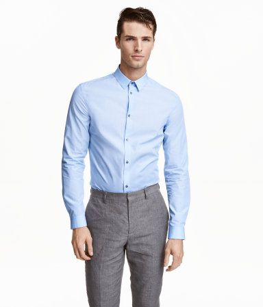 Light blue. PREMIUM QUALITY. Long-sleeved premium cotton shirt in textured…