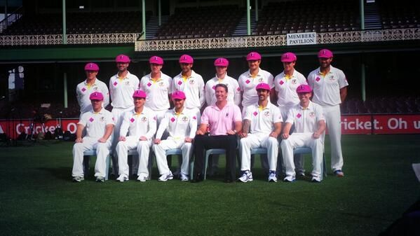 Twitter.  The Australian Cricket Team with Glen McGrath in their Pink Baggy Greens.