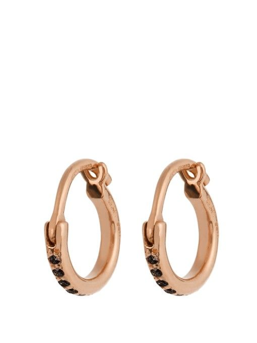 Ileana Makri uses delicate forms to make the most impactful and beautiful of jewellery. These mini hoop earrings are crafted from 18kt rose-gold, and pavé set with black diamonds, totalling 0.16ct. See how they make simple day looks instantly more refined. | Available at MATCHESFASHION.COM
