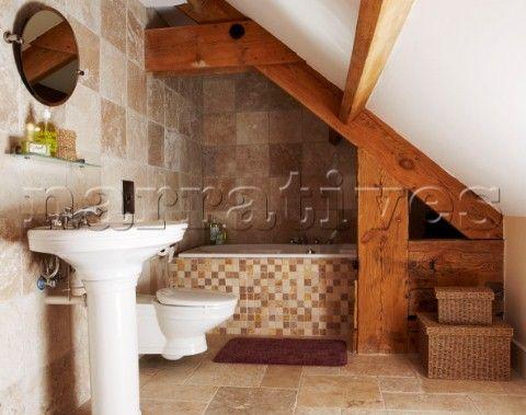 Pedestal basin in tiled bathroom with bath under eaves for Bathroom design under eaves