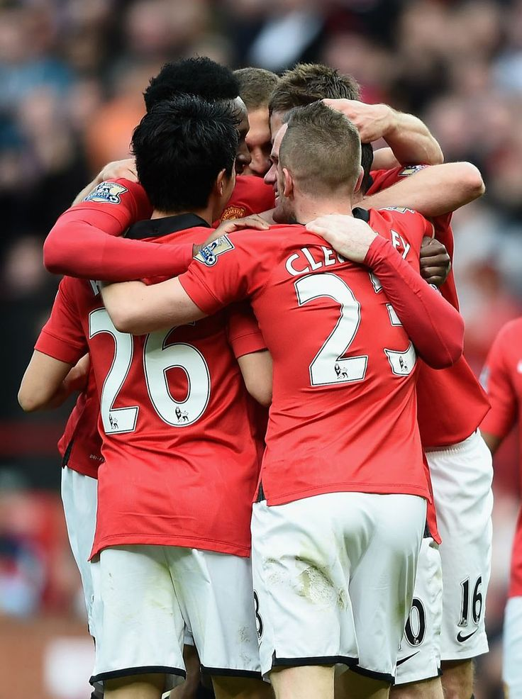Wayne Rooney of Manchester United is mobbed after scoring his second goal