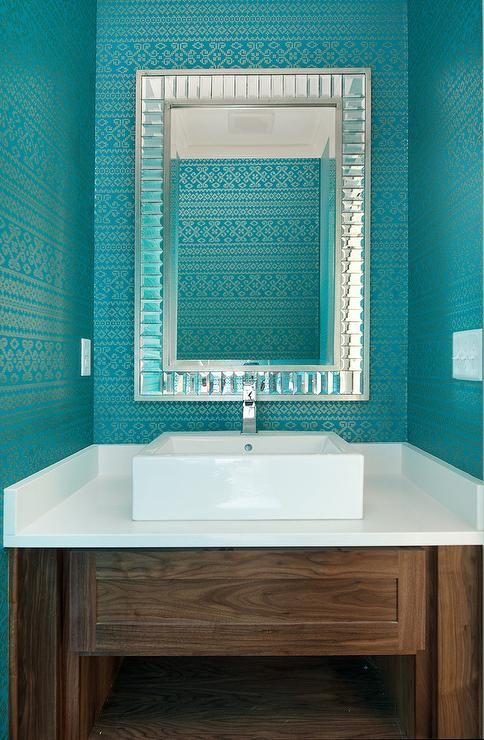 Contemporary powder room features walls clad in turquoise metallic wallpaper lined with a
