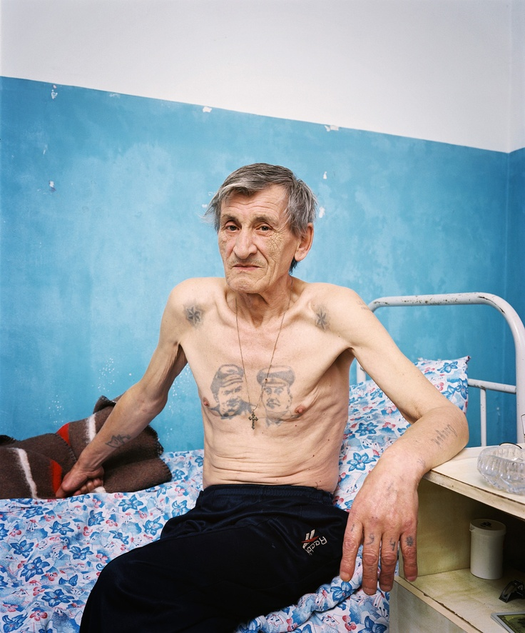Vladislav Vladimirovich Demyanov (63) in Gulripsh Hospital, the centre of MSF's tuberculosis programme in Abkhazia. Demyanov got infected with TB in the prison camps of southern Russia, where he also got his tattoos. He is suffering from multidrug-resistant tuberculosis, one of the former Soviet countries' most frightening health scourges.   From: Empty land, Promised land, Forbidden land (2010)  www.facebook.com/thesochiproject  © Rob Hornstra/INSTITUTE